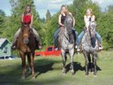photo of neighbor girls riding my horses